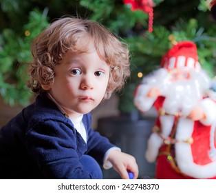 Little boy close to a Christmas tree