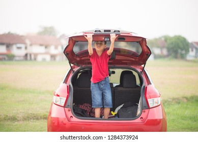 Little boy closing the back door car