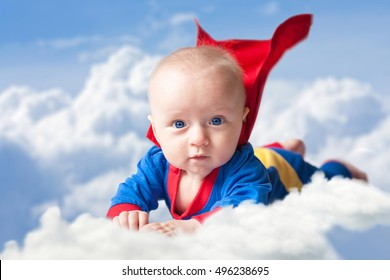 the little boy in the clothes of a superhero. The baby is flying in the sky. The child will save the world.