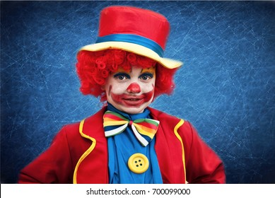 Little boy in a clown costume on a halloween party