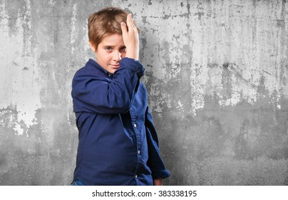 little boy combing himself on white