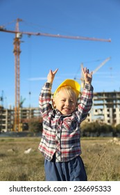 little boy at a construction site in the form of working