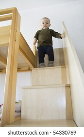 The little boy costs at a step and looks downwards