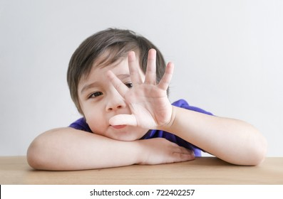 Little boy counting five, Cute kid showing 5 fingers or five numbers with fingers, Education or Toddler development concept