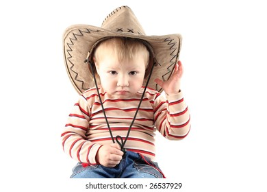 d3273ab039959 Little boy in cowboy hat isolated on white background