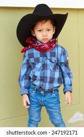 little boy in cowboy suit