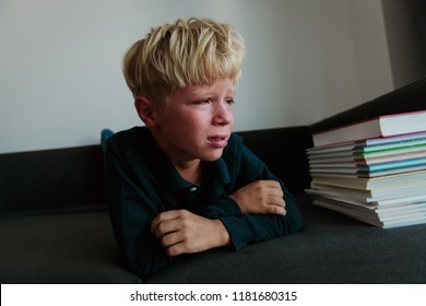 little boy cry tired of doing homework, overload, stress
