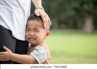 Little boy crying with his mother