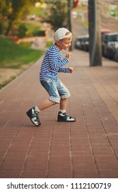 little boy dancing on the street