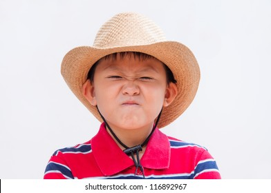 Little boy with a disgusted or fed up expression.