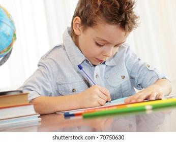 Little boy does a homework