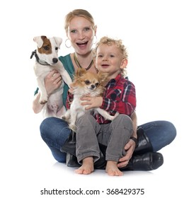 little boy, dogs and mother in front of white background