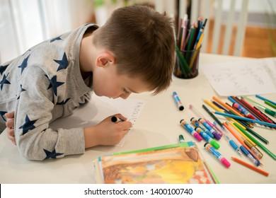 The little boy is doing homework