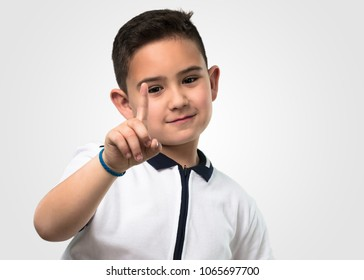 little boy doing number one gesture