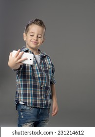 Little boy doing photo of her self over