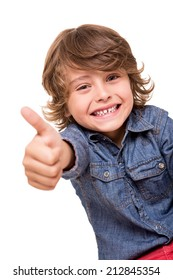Little boy doing thumbs up for camera