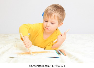 little boy drawing, education and daycare concepts