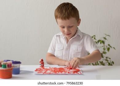 little boy draws