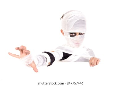 little boy dressed as a mummy on halloween isolated