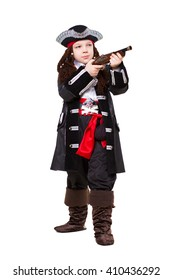 Little boy dressed as pirate posing with a gun. Isolated on white