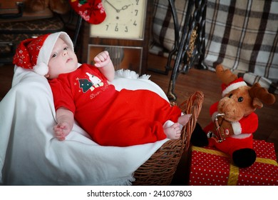 Little boy dressed in x-mas costume laying in the basket