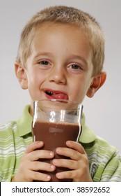 Little boy drinking chocolate drink,boy drinking milk,