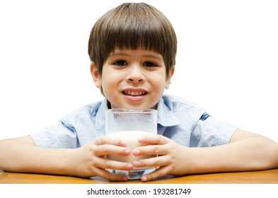 Little boy drinking milk with smiling