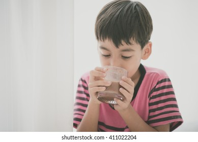 Little boy drinking milk vintage color style