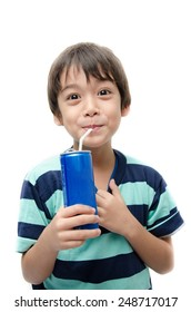 Little boy drinking soft drink can on white background