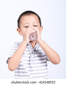 Little boy drinks fresh water