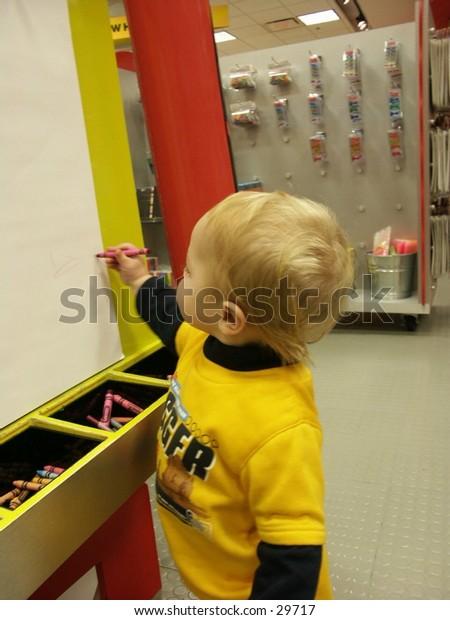 little boy at an easel