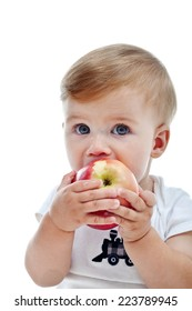 Little boy eating a big red apple - isolated