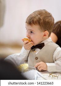 Little boy eating cookie