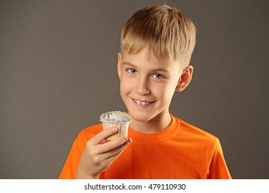 little boy eating cupcake