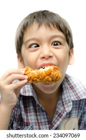 Little boy eating fried chicken on white background