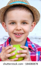 Little Boy Eating Green Apple