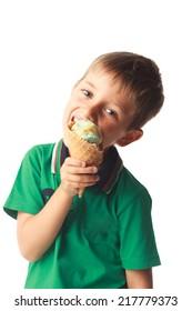 Little boy eating ice cream isolated on white background