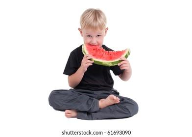 Little boy eating a slice of watermelon