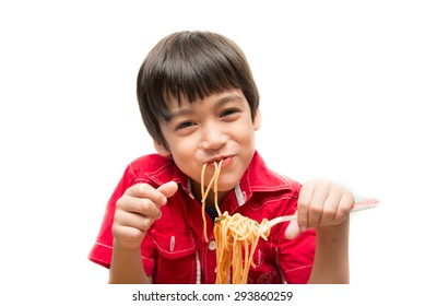 Little boy eating spaghetti