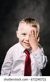 little boy emotions. face palm