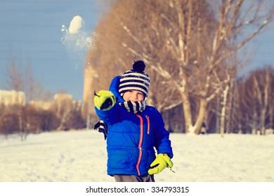 little boy enjoy snow in winter nature, kids winter fun
