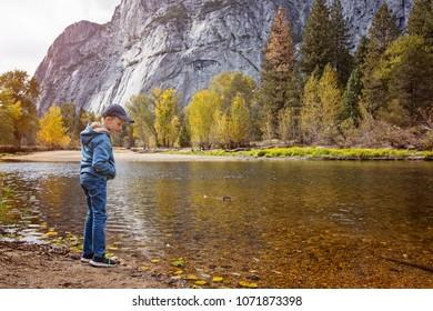 little boy enjoying beautiful views in yosemite national park, california