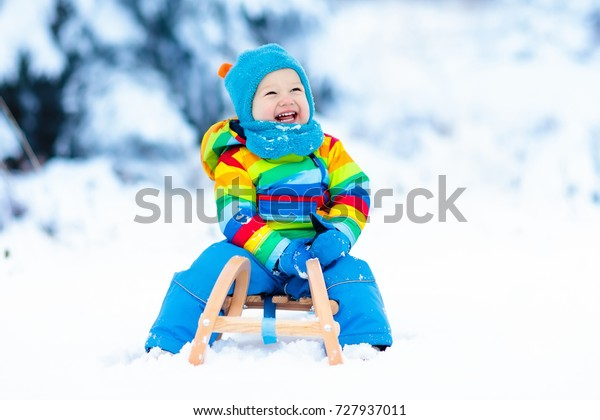Christmas Vacation Sled.Little Boy Enjoying Sleigh Ride Child Stock Photo Edit Now