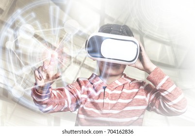 Little boy experiencing virtual reality. (Cross processed image with digital effects)