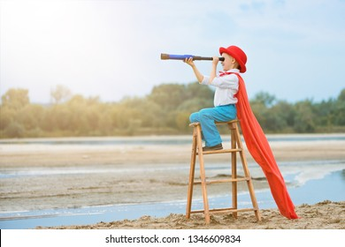 little boy explorer  with a telescope on a ladder, outdoor,side view,