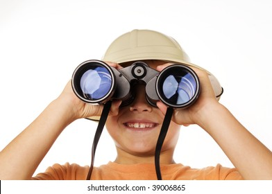 Little boy exploring looking through binoculars