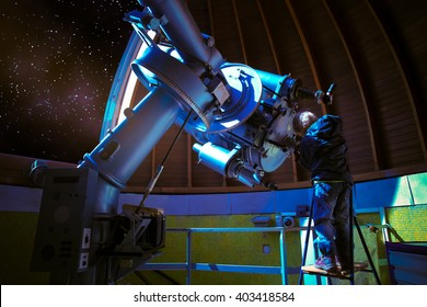 LITTLE BOY EXPLORING THE NIGHT SKY IN OBSERVATORY