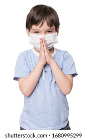 Little boy with face mask praying, isolated on white background