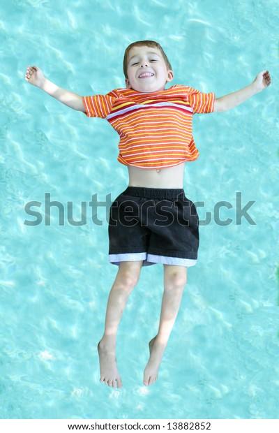 Little Boy Falls Backwards Into Swimming Stock Photo (Edit