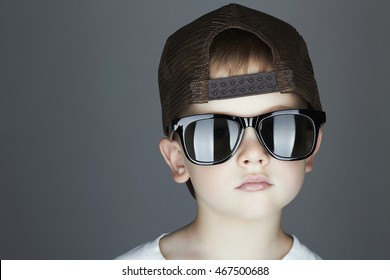 little boy. fashion children.handsome in sunglasses and Tracker Hat. Serious Child in Cap